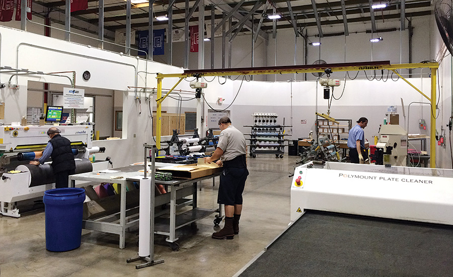 Employees prepare print runs inside Poly Print's 77,000-square-foot facility