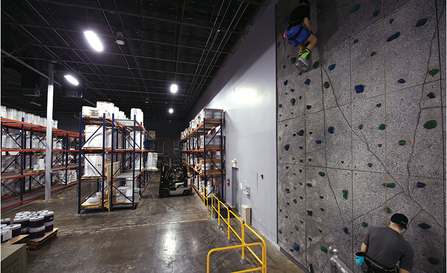 Features such as this rock climbing wall are designed to create a great working atmosphere for Popular Ink employees